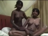 Afro lesbians fingering pussies on bed