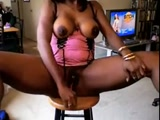 Black chick use toy to squirt
